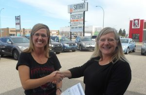 Lana Siman Present Colleen Ostoroff of Great Plains College with a cheque for 2 new scholarships